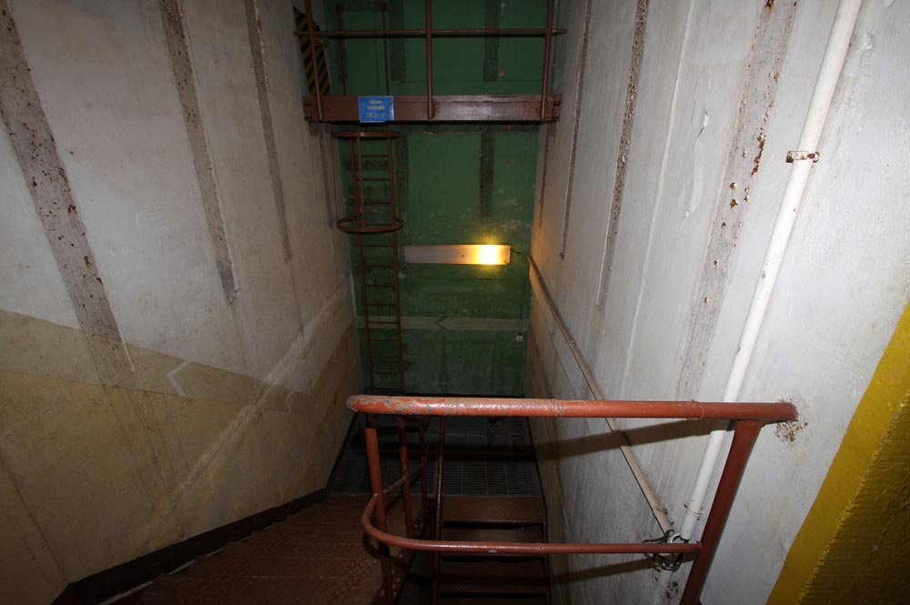 The stairway between the two floors. Also the well for the site under the floor.
