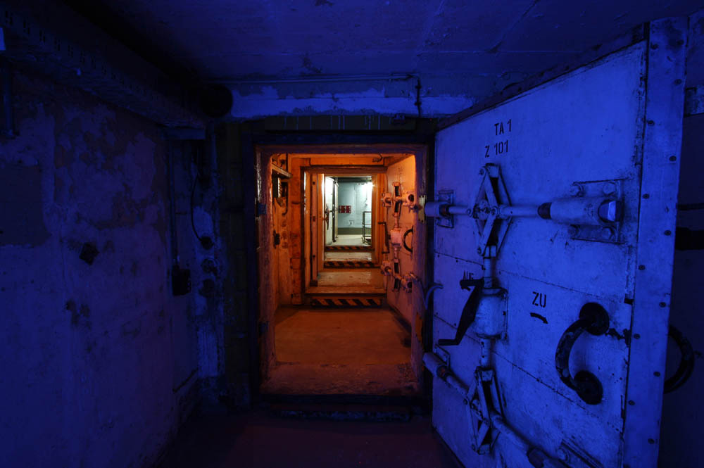 Main entrance seen from outside the bunker. The corridor having a darkblue glow.